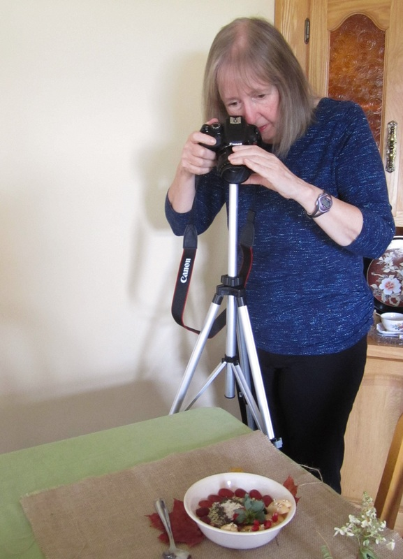 Beverley taking a photo of a bowl of porridge