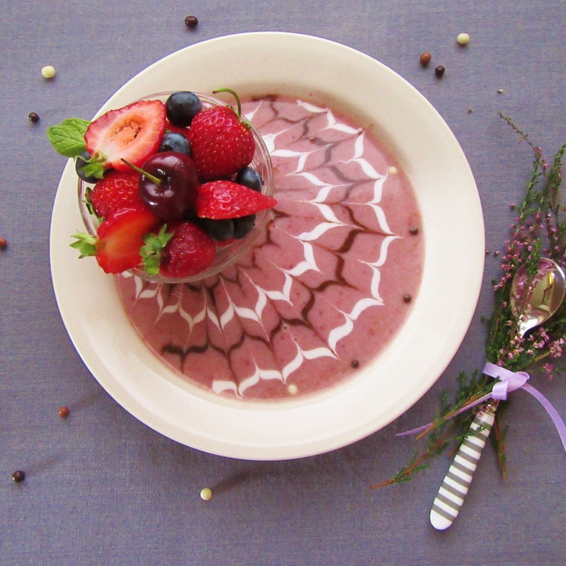 Berrylicious Smoothie Bowl with a yogurt garnish in a chevron design.